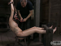 Tough beauty is hoisted up and given snatch punishment